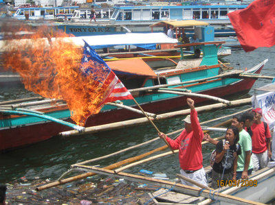 Fisherfolks burn US flag to signify their strong opposition to US-RP Balikatan in Bicol